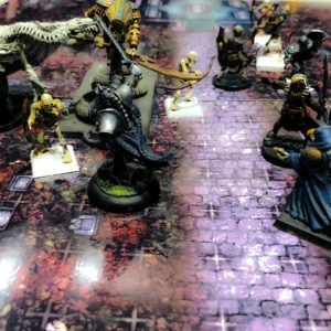 Dungeons and Dragons 5th edition party fights off undead in a graveyard