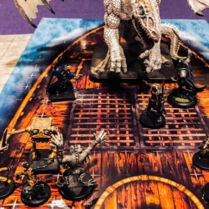 Dungeons and Dragons 5th edition adventures fight a dragon on a ship