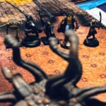 Partry of 5th edition Dungeons and Dragons adventures looking at a Beholder